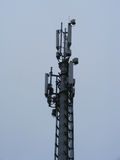Mast of cellular communication with microwave antenna Royalty Free Stock Photos