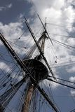Mast and clouds. Mast of an old warship reaching for the sky and clouds Royalty Free Stock Photography