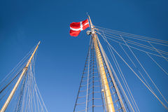 Mast and Danish flag on a large sailing Stock Photography