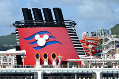 Mast of a Disney Cruise Ship. Mask of a Disney cruise ship also showing the water slide and the iconic emblem Stock Photography