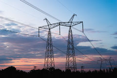 Mast electrical power line against cloud and blue sky.  Stock Photos