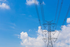 Mast electrical power line against cloud and blue sky background Stock Photography