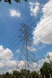Mast electrical power line against cloud and blue sky. Stock Image