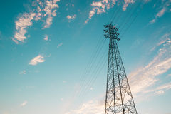 Mast electrical power line against sky. Royalty Free Stock Photography