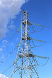Mast electrical power line in a wheat field on a sunny day Stock Images
