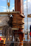Mast hoops. Are used to secure the leading edge of a sail to create proper airflow on old schooners like these on the Pride of Baltimore II. The beaded line royalty free stock photography