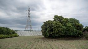 Mast ist Gestalt auf der Landschaft Stockbilder