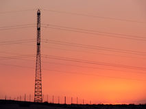 Mast of a line of transfer of an electricity. Mast of a line of transfer of an electricity, in the evening against the coming sun. Israel, desert Negev Stock Photography