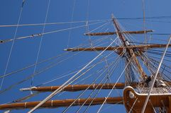 Mast of an old sailboat. The mast and rigging of an old sailboat stock photos