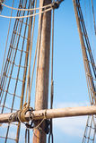 Mast, Rigging and Ropes of old sailing boat. Detail of mast of old historic wooden sailing ship, with rigging and ropes, blue sky and copy space Stock Photography