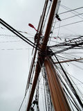 Mast and rigging on sailboat. Low angle view of mast and rigging on sailing boat royalty free stock photos