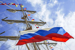 Mast and russian flag flying. Mast of tall ship and russian flag flying Royalty Free Stock Images