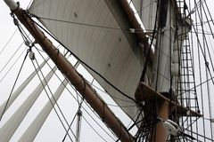 Mast and sail. Detail of a mast and sail of a large sailboat Stock Image