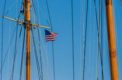 Mast of Sailboat. Ropes hanging from the mast of a sailboat against a blue sky royalty free stock photos