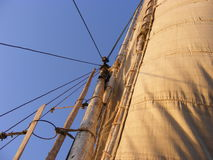 Mast of a sailing boat and blue sky. Sails on a small ship, simple photo of blue sky and a mast of a sailing boat on the river at sunset, simple beautiful stock Royalty Free Stock Photo