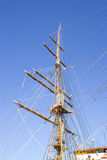 Mast sailing ship against a blue sky Royalty Free Stock Photography