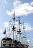 Mast sailing ship and a Russian flag Stock Image