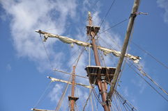 Mast and Sails. Mast and furled sails of a traditional sailing boat in the Cayman Islands stock images