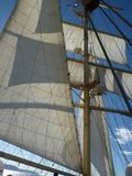 Mast with sails. Blown sails at cruising ship with shrouds Stock Photography