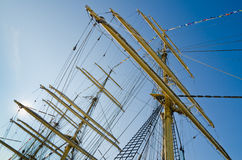 Mast with sails of old sailing vessel Stock Photography