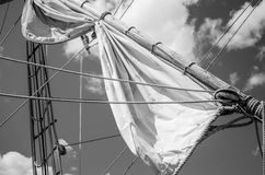 Mast with sails of an old sailing vessel Stock Images