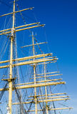 Mast with sails of an old sailing vessel Stock Photos