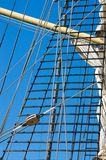 Mast with sails of an old sailing vessel Royalty Free Stock Images