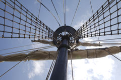 Mast and sails. Old vessel mast and roled up sails Royalty Free Stock Photos