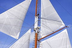 Mast and sails of sailing boat Stock Photo