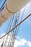 Mast, sails and shroud of a tall ship. Rigging detail. Stock Image