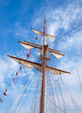 Mast of a ship. With furled sails Stock Photography