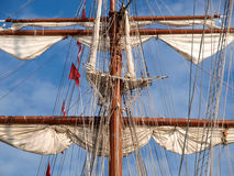 Mast of a ship detail. Mast of a ship with furled sails detail Royalty Free Stock Photos
