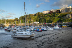Mast ship, fishing boats and yachts in the harbor of Ilfracombe. Low tide. North Devon. UK stock images
