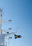 Mast of a ship with flag Stock Photography