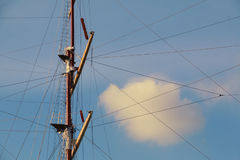 Mast of a ship on sunset sky background Royalty Free Stock Image