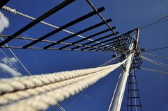 The mast of the ship, which goes to Mount Athos. On a background of the blue sky royalty free stock images