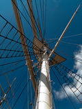 Mast and shrouds on sq-rigged shp. Mast and shrouds supportng mast on a square rigged ship with the top and yard seen royalty free stock images