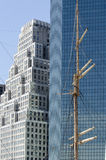 Mast and Skyscrapers. The Mast of a Vessel Contrasts with the Skyscrapers of New York Stock Photo