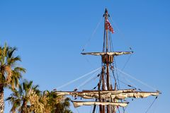 Mast of the spanish replica of the Nao de Santa Maria with some palm trees. Mast of the spanish replica of the Nao de Santa Maria vessel with some palm trees Royalty Free Stock Photo