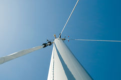 Mast top. Top of a mast in a sunny day with navigation equipment Royalty Free Stock Photography