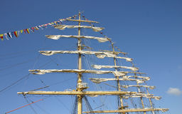 Mast with white sails Royalty Free Stock Image