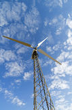 Mast with wind power generator against the sky, view from below. Stock Photo