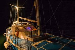 mast of a yacht without sails at night royalty free stock images