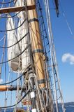 Mast, yardarms, rigging and sails Stock Images