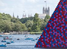 Mastaba art installation by Christo, floating on the Serpentine Lake in Hyde Park, with the Houses of Parliament in the background