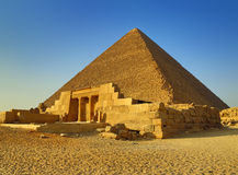 Mastaba and Great Pyramid in Egypt. The entrance of the mastaba of Seshemnufer IV and the Great Pyramid in background. Giza, Cairo, Egypt Stock Photography
