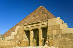 Mastaba of Seshemnufer IV. Egypt. Cairo - Giza. The entrance of the mastaba of Seshemnufer IV (late 5th Dynasty) and the Great Pyramid in background. The Pyramid Stock Photos