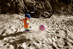 Master. Boy playing soccer on the beach Royalty Free Stock Photo