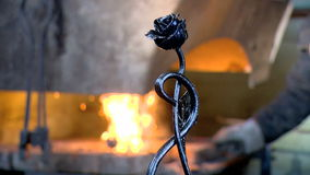 Master, anvil, treatment, workshop, tradition, folk. A blacksmith forges from a metal work of art stock footage