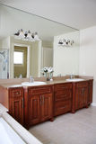 Master bath. Luxurious masterbath with jack and jill sinks and a huge mirror Stock Image